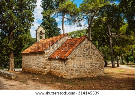 Stone old church of Krka National Park is one of Croatian national parks, named after river Krka that it encloses. It is located along middle-lower course in central Dalmatia, in Sibenik-Knin county - stock photo