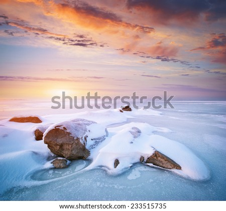 Stone on ice. Winter landscape.  - stock photo