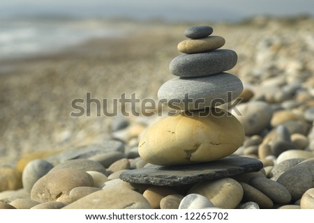stone on stone, a top of the together sand to the sea... - stock photo