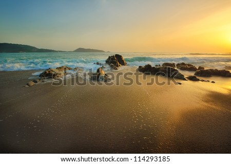 stone on the beach in twilight - stock photo