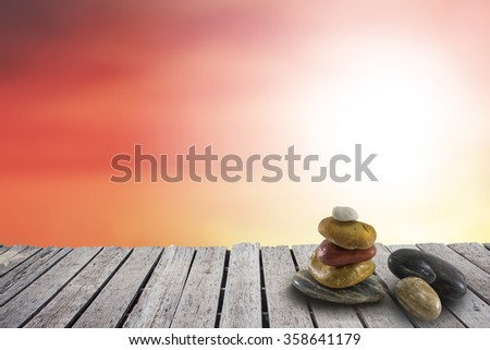 Stone on Wood terrace with the blurred background. spa concept - stock photo