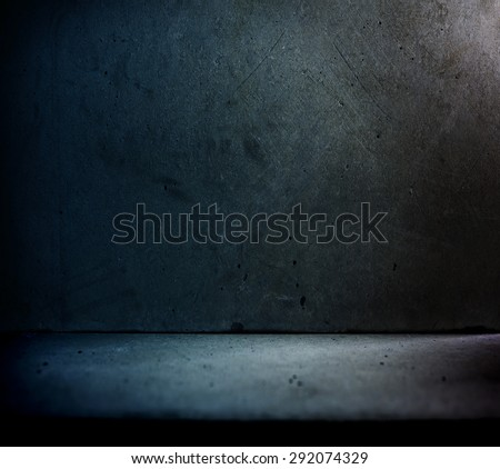 Stone or concrete wall and floor with backstreet like lighting. - stock photo