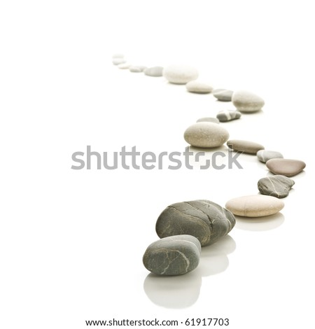 Stone path arranged to a zigzag. Fades to white background. Square format. - stock photo
