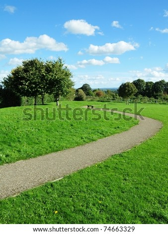 Stone Path in a Lush Green Park - stock photo