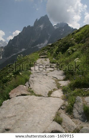 Stone path in the alps - stock photo
