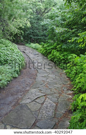 Stone pathway in the Arboretum located at the Montreal Botanical Garden.  Montreal, Quebec, Canada. - stock photo