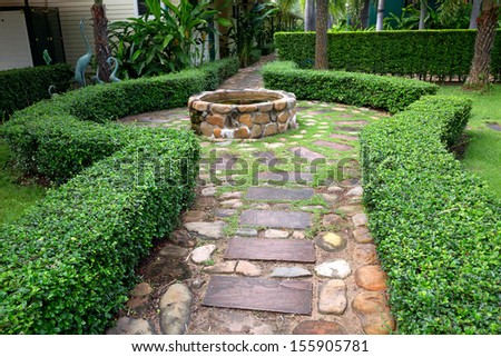 Stone pathway in the garden park. - stock photo