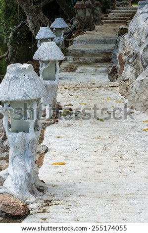 Stone pathway in the garden with light column - stock photo