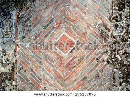 Stone pavement texture. Granite cobblestoned pavement background. Abstract background of old cobblestone pavement close-up. Brick wall background - stock photo