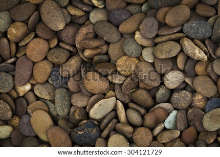 Stone pebble as a background. - stock photo