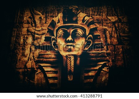 Stone pharaoh tutankhamen mask on dark background - stock photo