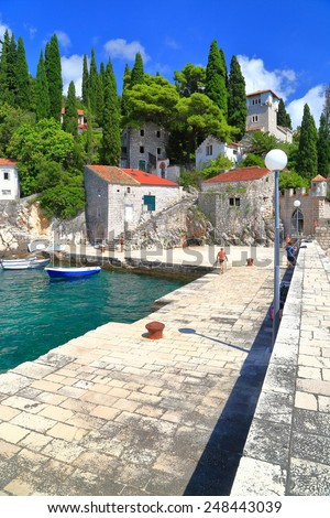 Stone pier protecting traditional harbor near the Adriatic sea, Trsteno, Croatia - stock photo