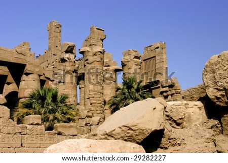 Stone pillars against the blue sky in the Temple of Karnak Luxor Egypt - stock photo