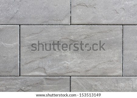 Stone plates in grey on a sideway with seams - stock photo