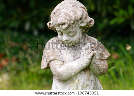 Stone praying child - stock photo