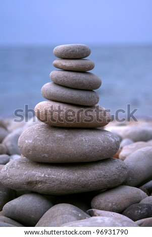 stone pyramid at the seaside - stock photo