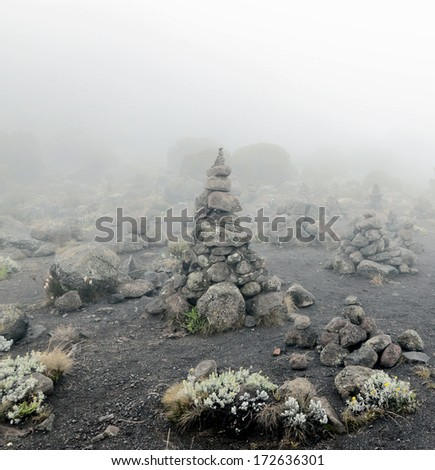 Stone pyramid near Zebra Rocks above the camp Horombo - Kilimanjaro, Tanzania - stock photo