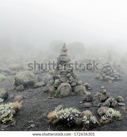 Stone pyramid near Zebra Rocks above the camp Horombo - Kilimanjaro, Tanzania - stock photo