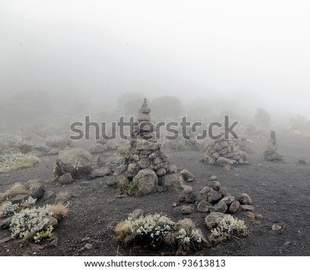 Stone pyramid near Zebra Rocks above the camp Horombo - Kilimanjaro, Tanzania, Eastern Africa - stock photo