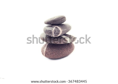 Stone pyramid on a white background