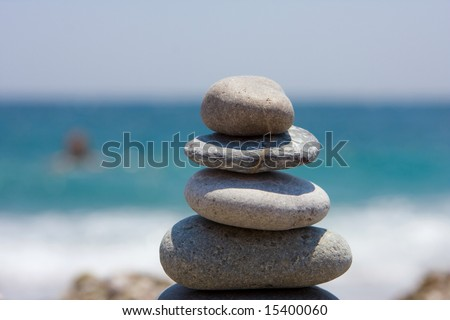Stone pyramid on clear see background