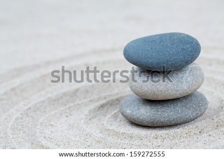 stone pyramid on sea sand - stock photo