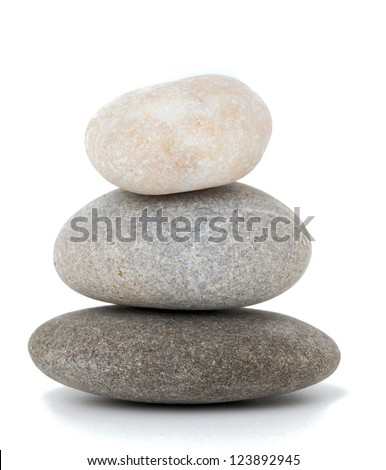 stone pyramid over white - stock photo