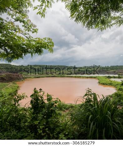 Stone quarry Thailand returning to nature, fish plants and wildlife recolonising abandoned stone quarry Asia. - stock photo