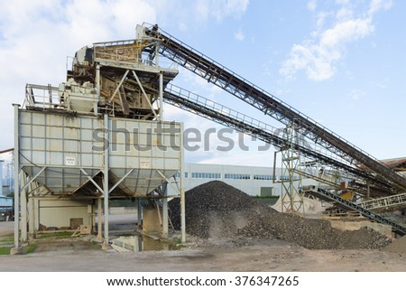 Stone quarry with silos and conveyor belts. Industrial equipment. Mining - stock photo