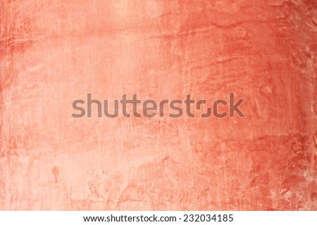 Stone red painted wall surface - stock photo