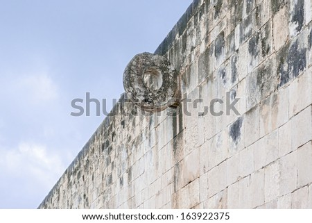 Stone Ring located 9 m (30 ft) above the floor of the Great Ballcourt, Chichen Itza.  Chichen Itza was one of the largest Maya cities and it was likely to have been one of the mythical great cities,