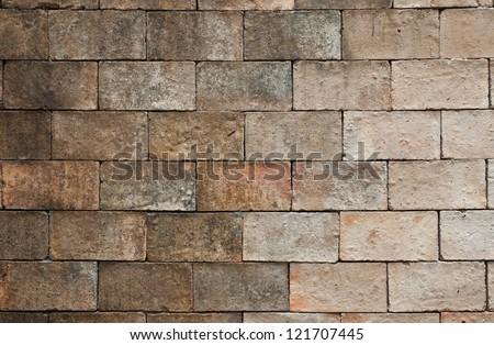 Stone rock brick block wall in ancient Thai northern city - stock photo