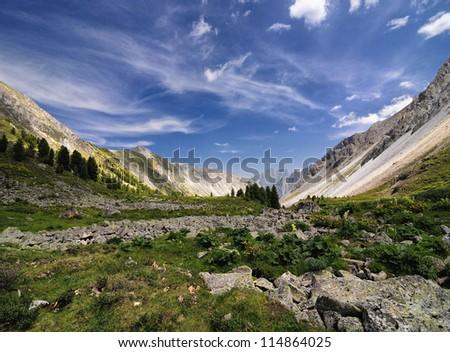 Stone run in an alpine meadow in the mountains of the Eastern Sayan. Republic of Buryatia - stock photo