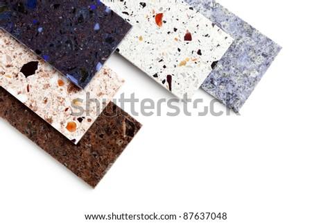 Stone samples for kitchen worktops on white background. - stock photo