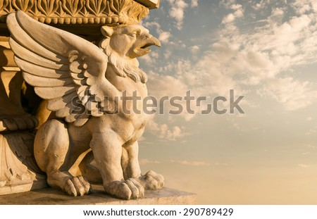 Stone sculpture of a gargoyle at the sunset - stock photo