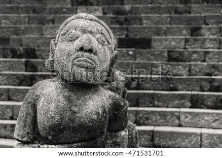 Stone sculpture of man from hindu temple Cetho, Jawa, Indonesia