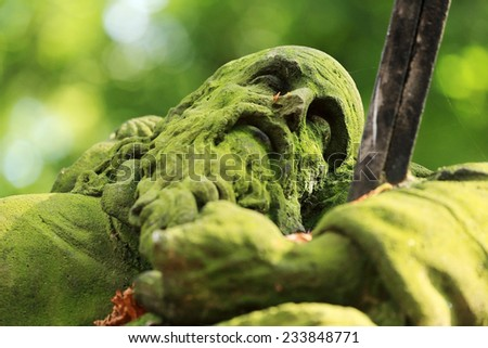 Stone Sculpture of the old Man from the old Prague Cemetery, Czech Republic - stock photo