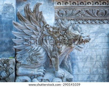 Stone sculpture on entrance door of Pura Padmasana Puja Mandala temple - stock photo