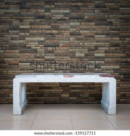 Stone seat with brick wall - stock photo
