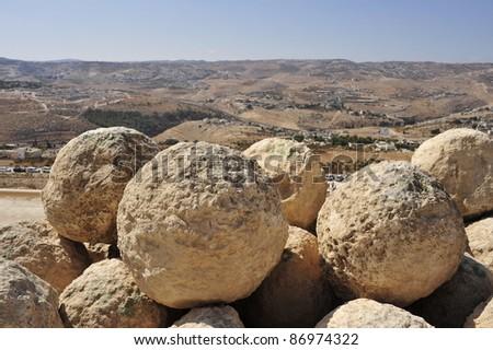 Stone shells prepared for Herodium fortress defense, Israel. - stock photo
