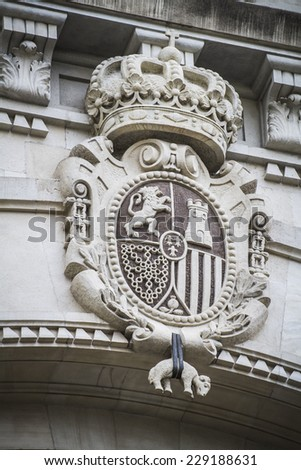 stone shield, Spanish city of Valencia, Mediterranean architecture - stock photo