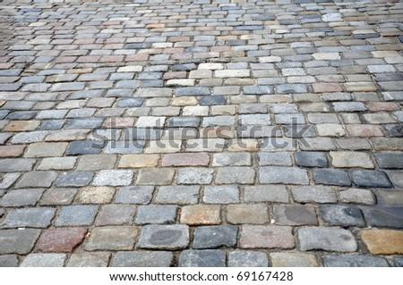 Stone sidewalk in Poznan Old Market, Poland as a background - stock photo