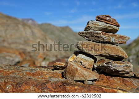 Stone sign along Valle Umbrina track at 3060 meters on the sea-level. Brixia province, Lombardy region, Italy - stock photo