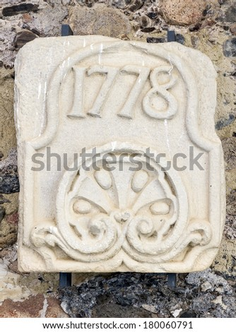 stone slab engraved with the year 1778. In the monastery of Poblet, Catalonia Spain - stock photo