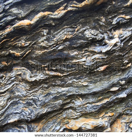 Stone slab of slate rock for background with copy space - stock photo