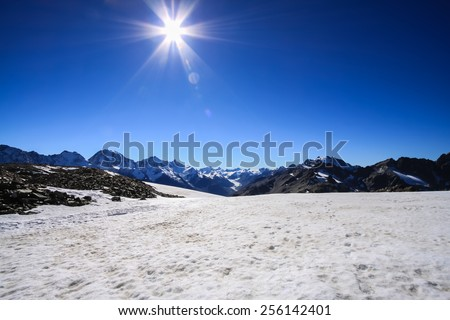 Stone Snow SunGlacier Helicopter - Fox Glacier, New Zealand - stock photo