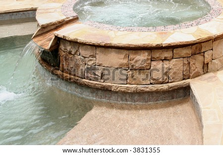 Stone spa and pool.