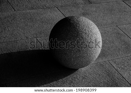 stone sphere in light and shadow
