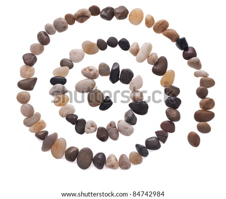 Stone spiral made from the beach pebbles isolated on the white - stock photo
