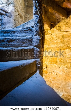 Stone Spiral Stairway in the Castle - stock photo